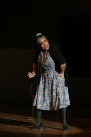Wanda Spence playing Ms. Hannigan (Annie).