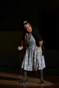 Wanda Spence playing Ms. Hannigan (Annie).